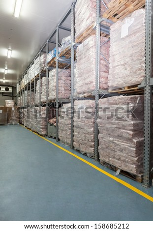 Refrigerator- huge warehouse with a frozen meat - stock photo