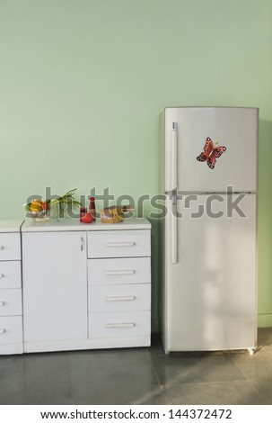 Refrigerator in the kitchen - stock photo