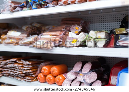 Refrigerator shelves with different meat products   - stock photo