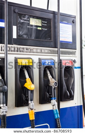 Refueling nozzle in gas station. Close up - stock photo