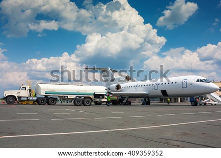 Refueling plane at a small airport - stock photo