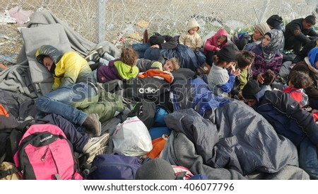 Refugees waiting at a checkpoint on the Greece-Macedonia border, near the makeshift camp in Idomeni, on March 6, 2016, Idomeni, Greece