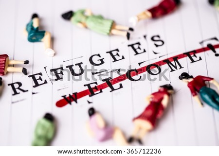 refugees welcome strikethrough text on white line paper with face off woman figures around - stock photo