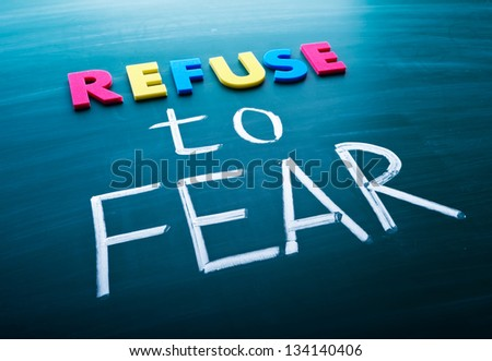 Refuse to fear, colorful conceptual words on blackboard. - stock photo