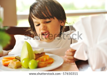 Refusing food, kid does not want to eat - stock photo