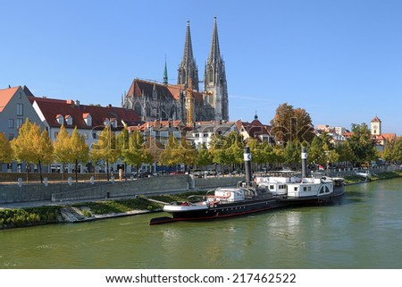 Regensburg Cathedral and old steamship at the shore of Danube river in Regensburg, Germany - stock photo