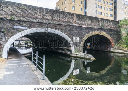 Regent's Canal. London, England. The Regent's Canal forms a junction with the old Grand Junction Canal at Little Venice, a short distance north of Paddington Basin. - stock photo