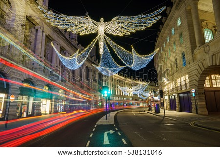 Regent Street with light trails and christmas decoration, central London