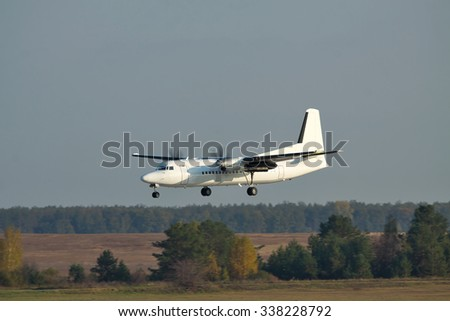 Regional turboprop passenger plane on short final landing - stock photo