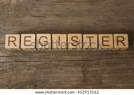 REGISTER word on wooden cubes - stock photo