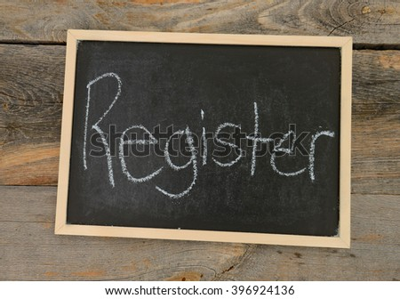 Register written in chalk on a chalkboard on a rustic background - stock photo