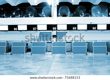 Registration tables in modern airport - stock photo