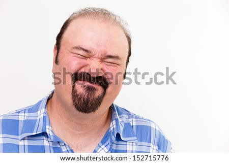 Regretfull expressive face on a man isolated on white - stock photo