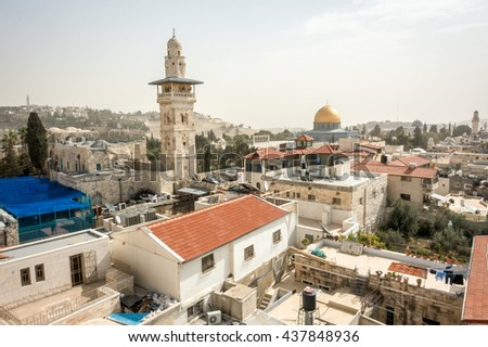Regular houses in Jerusalem with famous Dome on the Rock - stock photo
