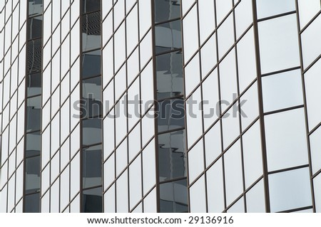Regular pattern shaped by the glass wall of the building - stock photo