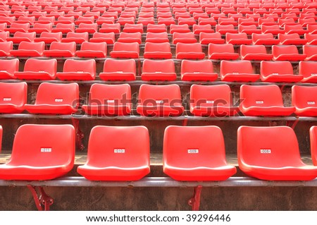 regular red seats in a stadium - stock photo