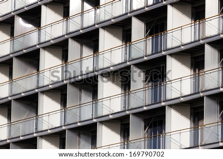 Regular structure of windows and balconies - modern building - stock photo