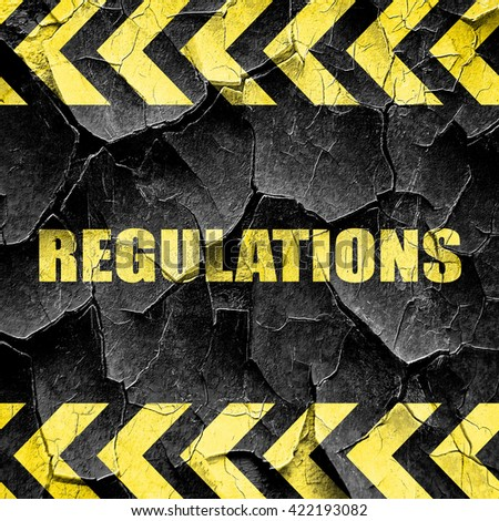 regulations, black and yellow rough hazard stripes - stock photo