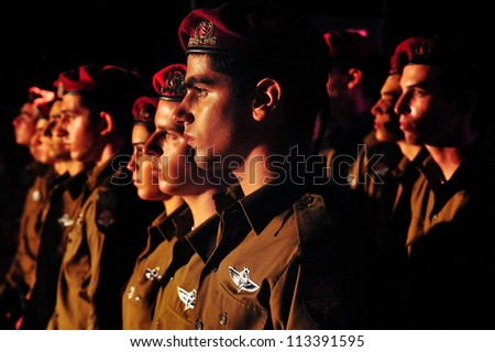REHUVOT - SEPTEMBER 16:Israeli soldiers during  moment of silence  at the memorial ceremony for fallen paratroopers force at the Monument in Tel Nof on September 16 2010 in Rehuvot, Israel.