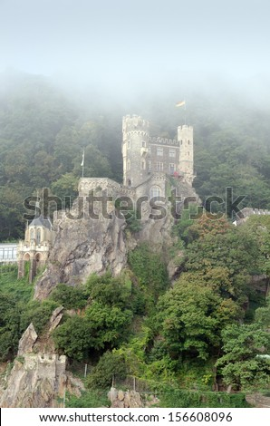 Reichenstein Castle, also called Falkenburg, is located above Trechtingshausen. The large construction is one of the spectacular examples of the castle reconstruction in neo-Gothic style - stock photo