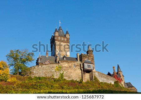 Reichsburg Cochem (Cochem Castle) along the Moselle River (Mosel) in Germany. - stock photo