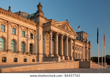Reichstag building in Berlin in evening light. The Reichstag is the meeting place of the Bundestag, the German parliament. - stock photo