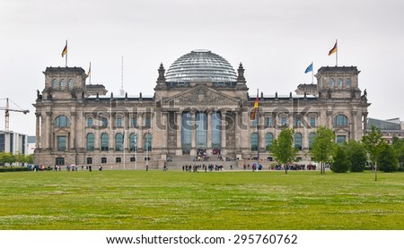 Reichstag building seen from the former Konigsplatz in Berlin, Germany, on a cloudy day - stock photo