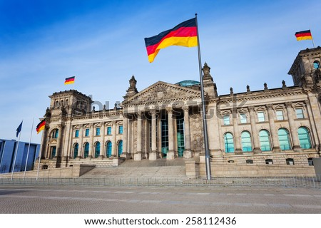 Reichstag facade view with German flags in Berlin, Germany - stock photo
