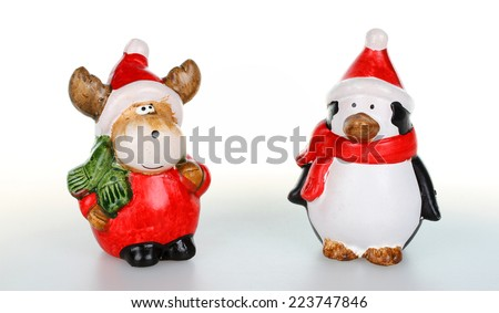 Reindeer and penguin with Santa clause outfit - stock photo