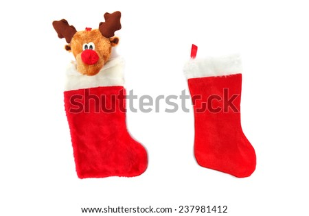 Reindeer Christmas and normal Red Stocking isolated on white  - stock photo