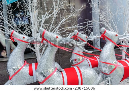 reindeer decorated for Chirstmas in front of mall, Saigon, Vietnam - stock photo