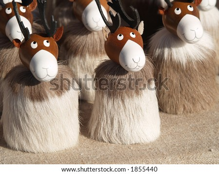 Reindeer souvenirs from reindeer fur in a market, close-up - stock photo