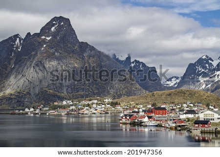 Reine - idyllic village by the breathtaking mountain scenery of the Lofoten  wall