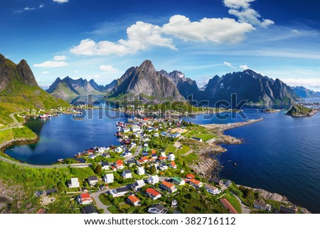Reine, Lofoten, Norway. The village of Reine under a sunny, blue sky, with the typical rorbu houses. View from the top