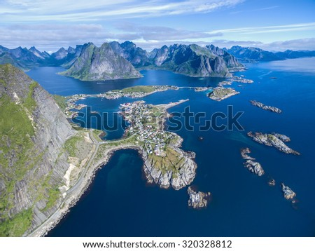 Reine surrounded by deep fjords and magnificent peaks on Lofoten islands in Norway - stock photo