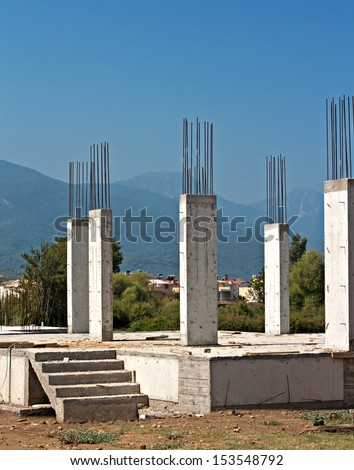 Reinforced concrete pillars on house under construction - stock photo