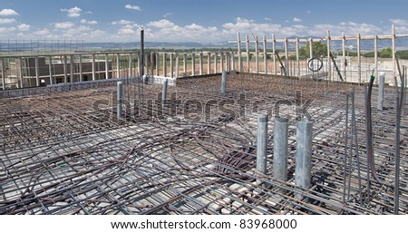 reinforcement metal framework and electricity wires before concrete pouring - stock photo
