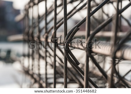 Reinforcement of concrete work. Using steel wire for securing steel bars with wire rod for reinforcement of concrete or cement. focus to steel wire - stock photo