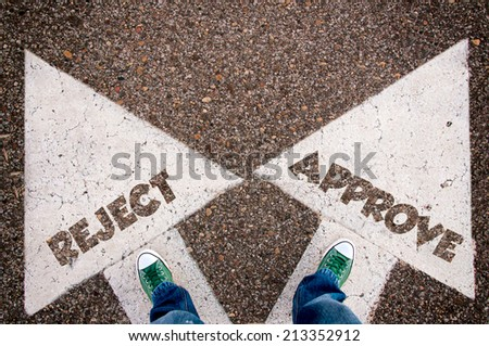 Reject and approve dilemma concept with man legs from above standing on signs - stock photo
