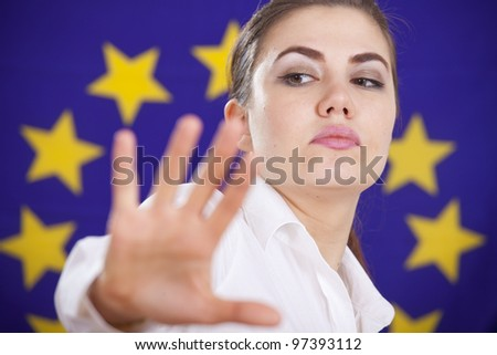 rejecting help or stop hand gesture from a woman over european flag - stock photo