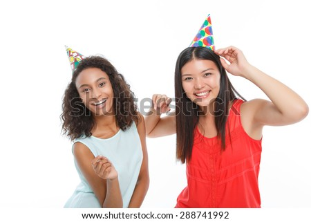 Rejoicing in party. Positive vivacious girls smiling and dancing while enjoying time. - stock photo