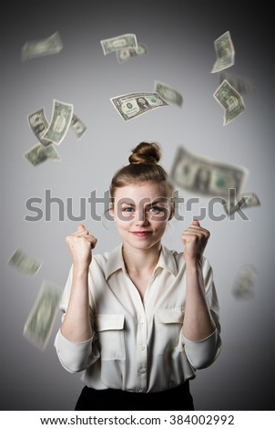 Rejoicing. Young slim woman and falling dollar banknotes. Success, currency and lottery concept. - stock photo