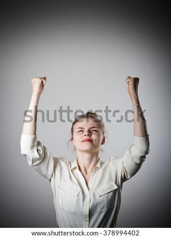 Rejoicing young slim woman. Success and winner concept. - stock photo