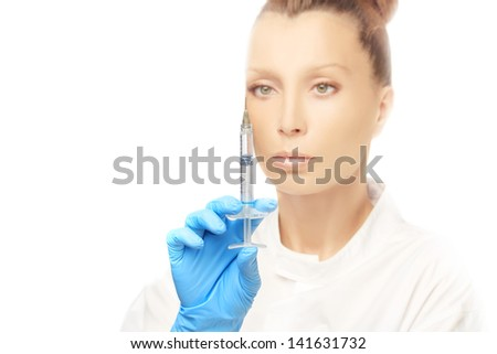 Rejuvenation.Attractive doctor prepare to Injection of beauty products - stock photo