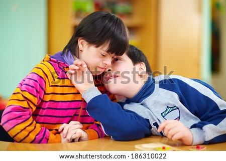 relations between kids with disabilities - stock photo