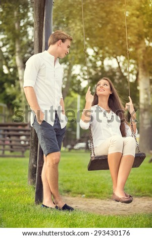 relationship and dating concept - romantic couple in the park - stock photo