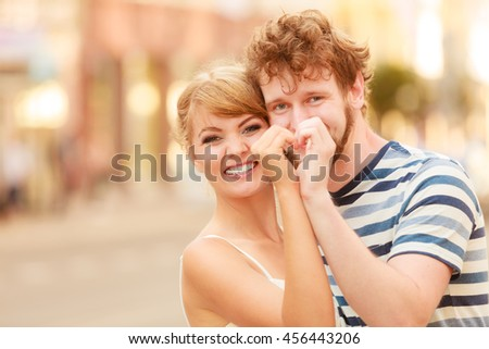 Relationship, love happiness concept. Romantic tourists couple walking in city street making heart form by hands. Happy woman and man enjoying life summer vacation outdoor