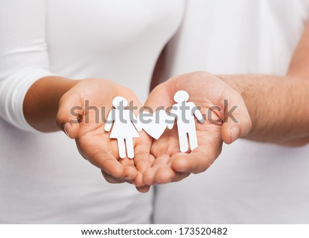 relationships and love concept - clousup of couple hands showing couple with heart shape