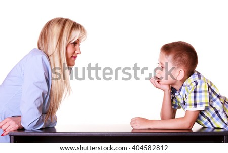 Relationships arguments and discussion. Mother and son sit at table and argue discuss solve problem. - stock photo