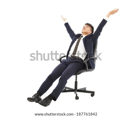 relax businessman sitting on a chair and raise hands - stock photo